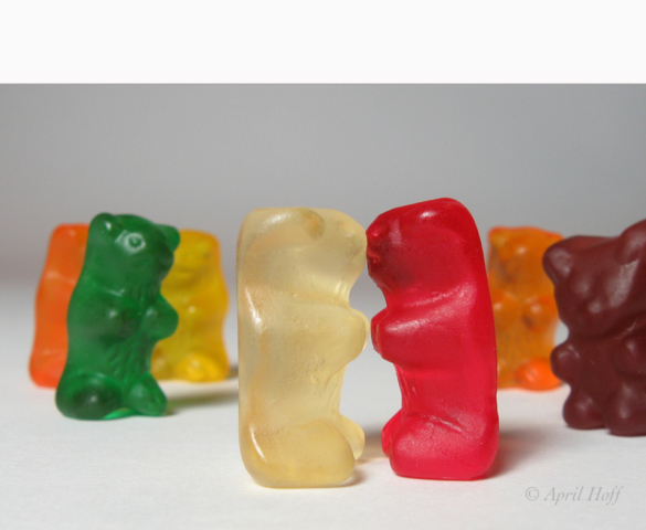 Colorful image of gummy bears kissing with onlooking gummy bear witnesses. © April Hoff